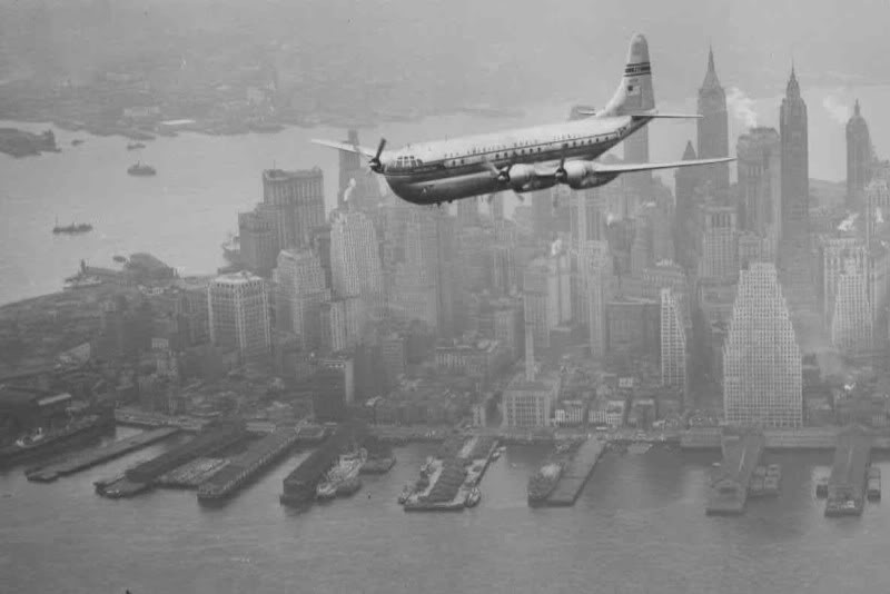 A Boeing Stratocruiser flies low over Manhattan, 1949.