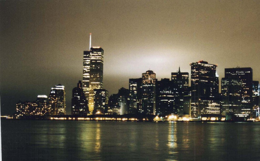 Night view of the illuminated lower Manhattan skyline. 1995.