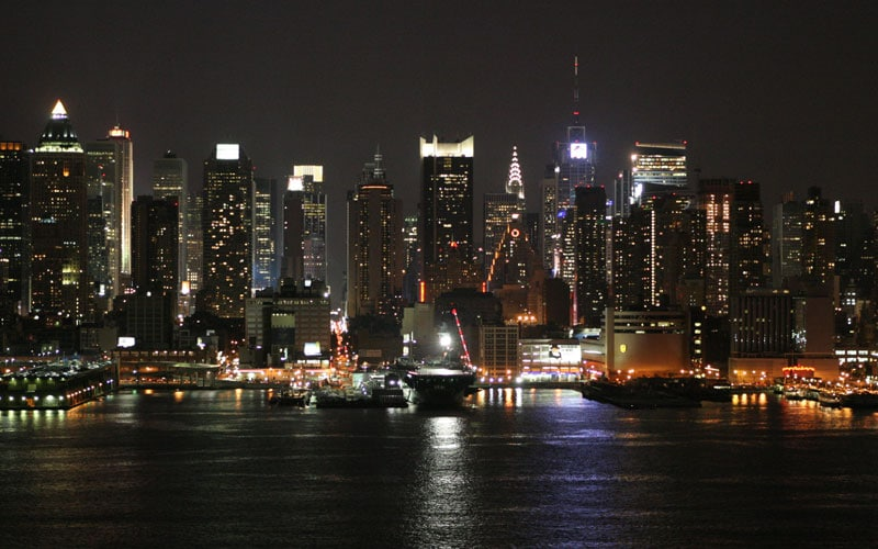 Night view of an illuminated Manhattan skyline from 6th August 2005.