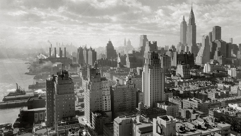 The completed Empire State Building standing at 1,250 feet (380 m) and Chrysler building loom large over Manhattan (1932)