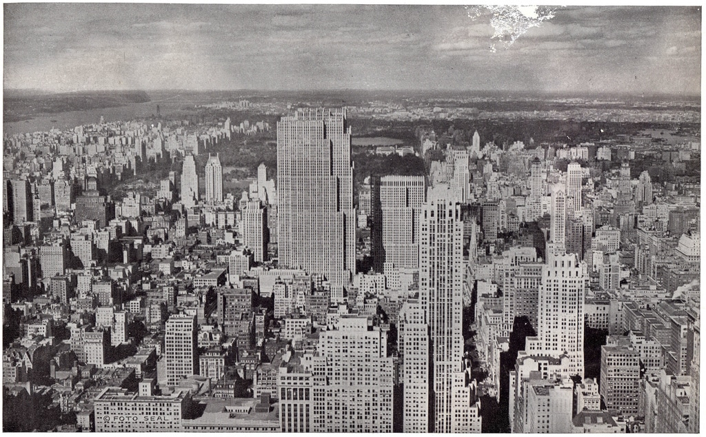 Midtown Manhattan looking north from Empire State Building in July 1935 with the Rockefeller Center's newly completed 41-story International Building.