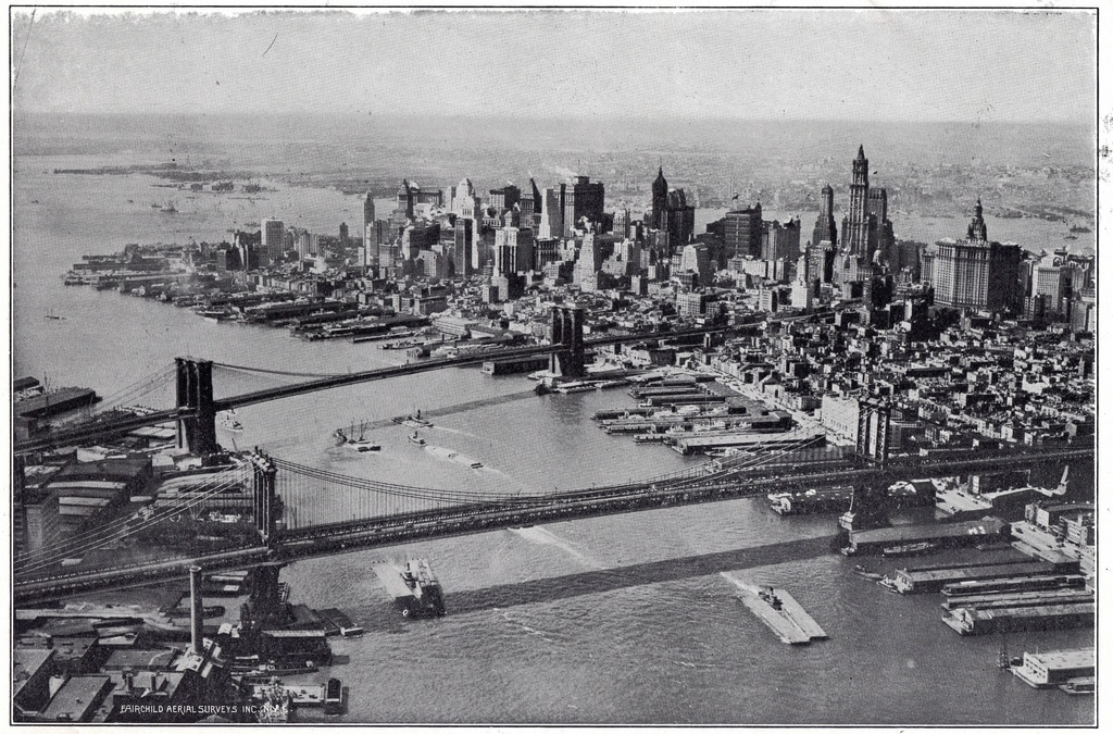 View across the East River, taking in Manhattan and Brooklyn bridge (1928).