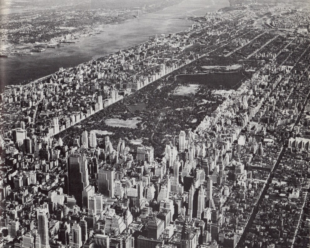 Aerial view of Midtown Manhattan looking northwest showing Central Park. August 1955.