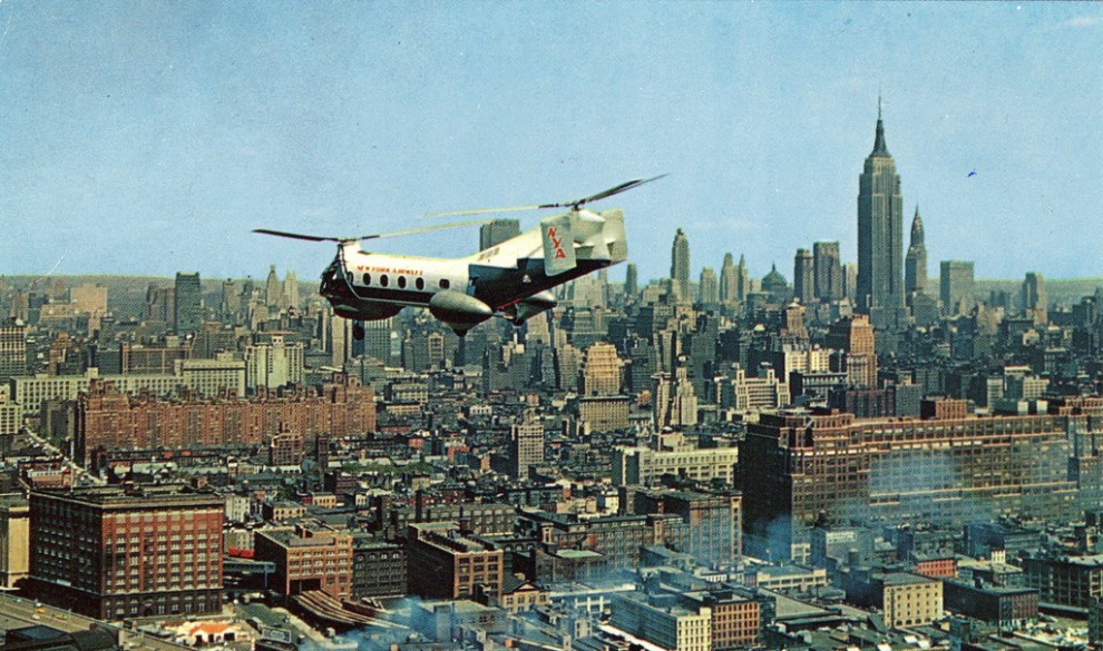 A helicopter flies over Midtown Manhattan in May 1958.