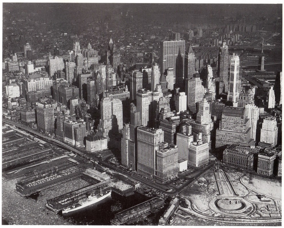 Aerial view of Lower Manhattan looking northeast from Hudson River. February 1961.