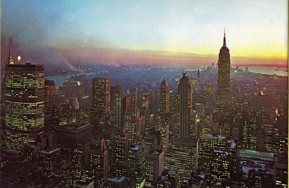 Night view of Midtown Manhattan looking southeast from RCA Building with Pan Am Building on left. Christmas 1963.
