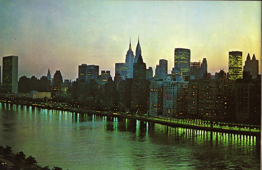 Night view of Midtown Manhattan looking southwest from Queensboro Bridge. June 1963.