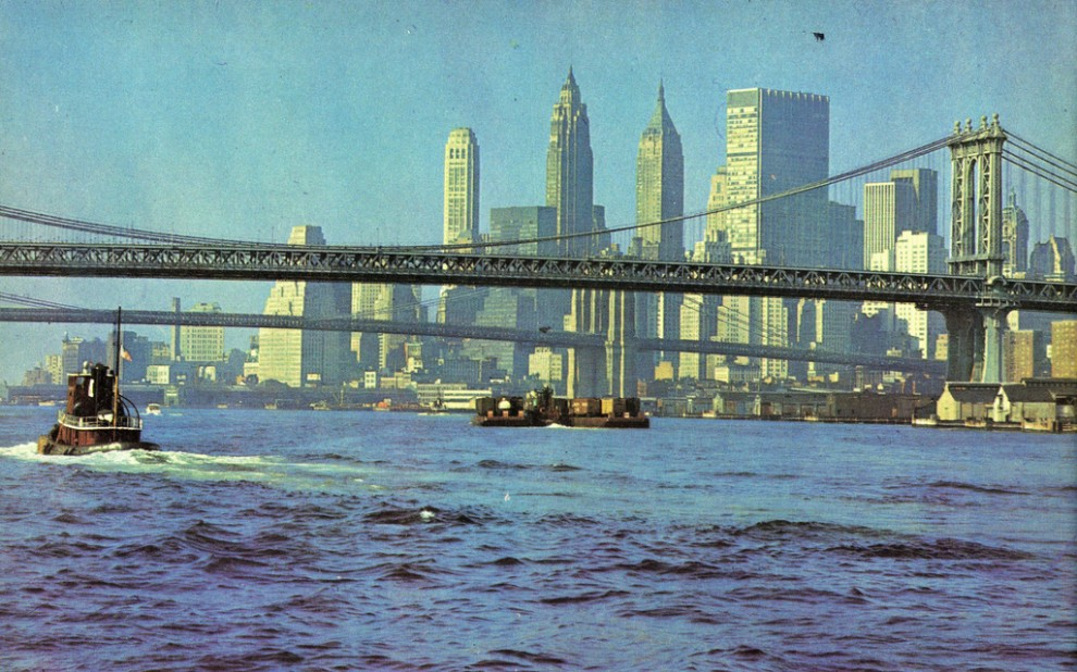Lower Manhattan and Brooklyn and Manhattan bridges viewed from East River looking southwest in July 1965.