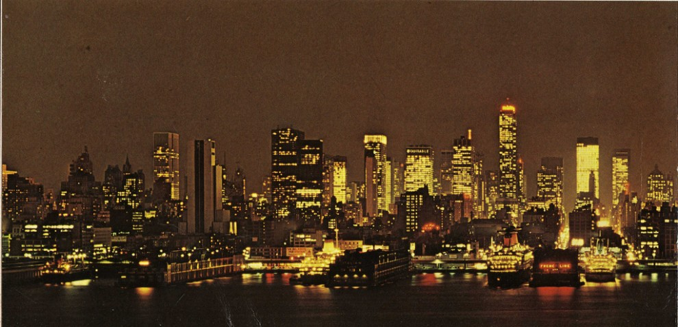 Night view of the evolving Midtown Manhattan skyline looking east from Hudson River. January 1969.