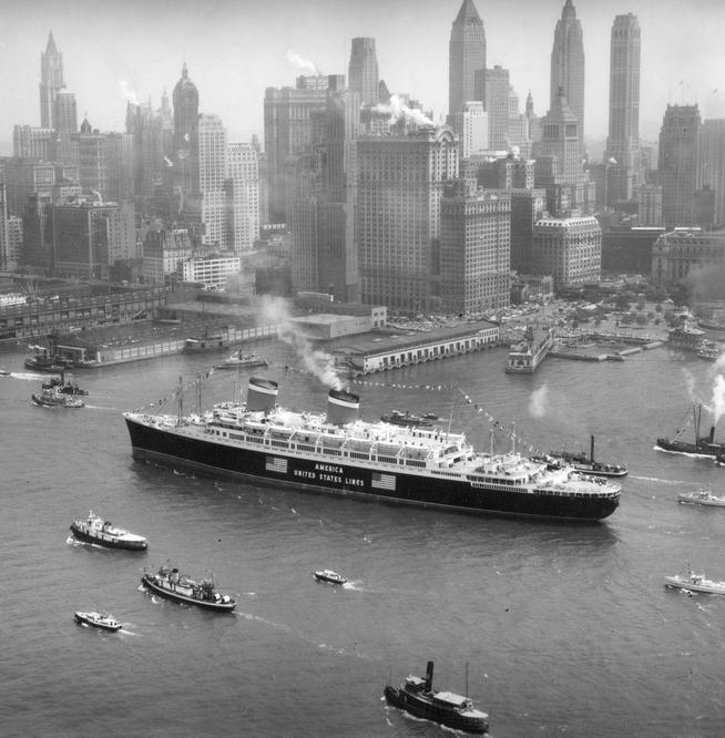 The S.S. America (built in 1940, the same year this photo was taken) makes its way up the busy Hudson River.