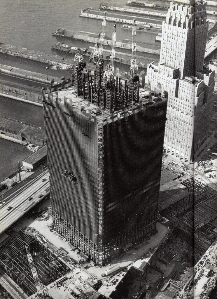 Aerial view of the North Tower of the World Trade Center Twin Towers (rising to 26 stories) under construction looking northwest. September 1969.