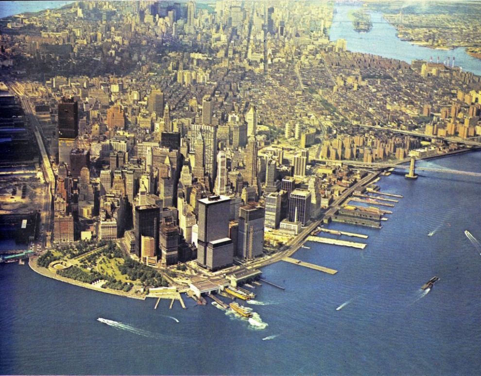 Aerial view of Manhattan Island looking north. May 1970. Construction of the World Trade Center is at an advanced stage.