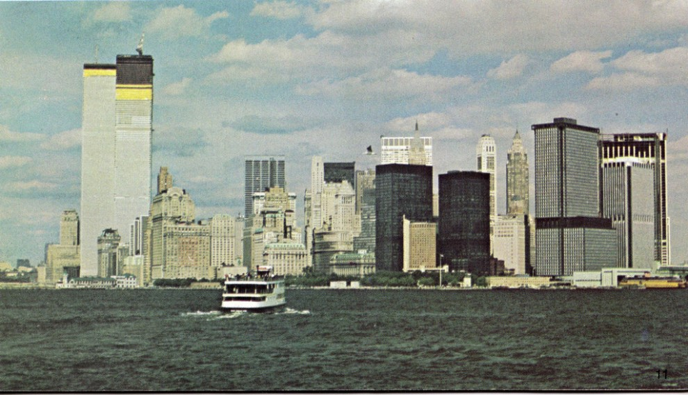 Lower Manhattan skyline looking north from Staten Island ferry, with the 110-story Twin Towers of the World Trade Center nearing completion. March 1972.