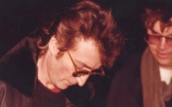 John Lennon signs an autograph for Mark Chapman, hours before his death.